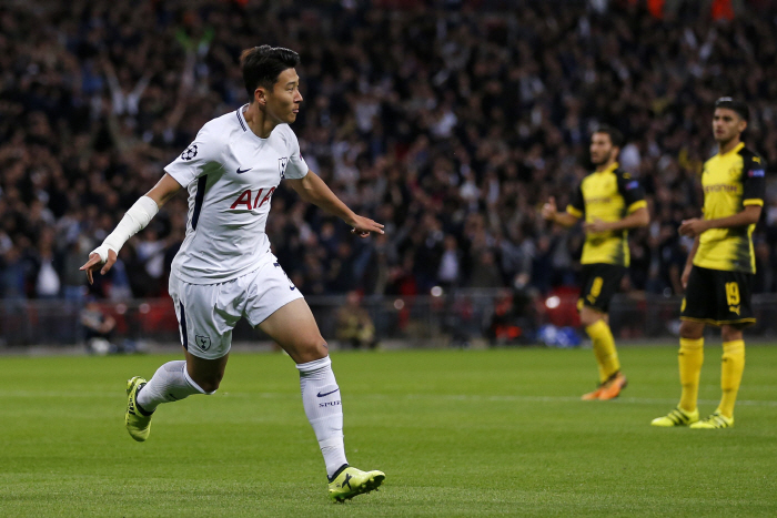 Tottenham Hotspur's South Korean striker Son Heung-Min celebrates after scoring the opening goal of ...
