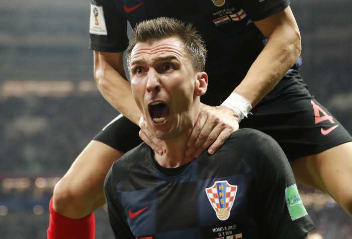 Croatia's Mario Mandzukic celebrates after scoring his side's second goal during the semifinal match...