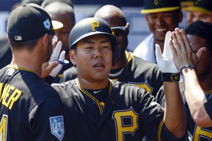 Mar 10, 2019; Tampa, FL, USA; Pittsburgh Pirates third baseman Jung Ho Kang (16) celebrates with tea...