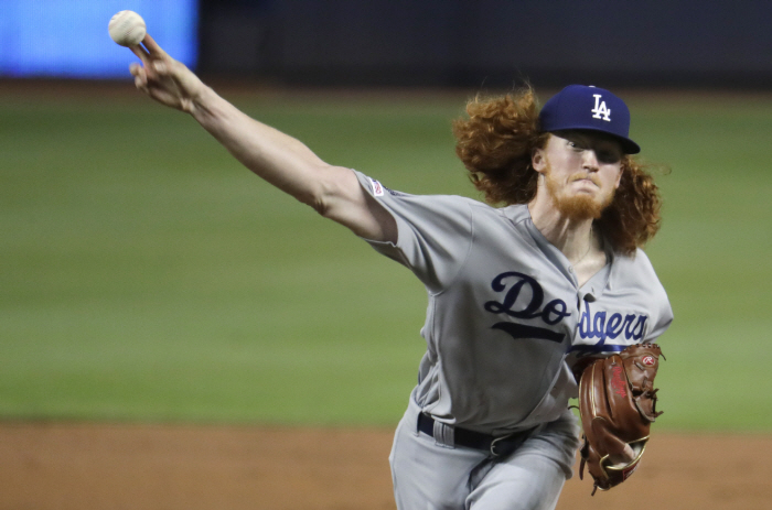 Los Angeles Dodgers starting pitcher Dustin May delivers during the first inning of the team`s baseb...