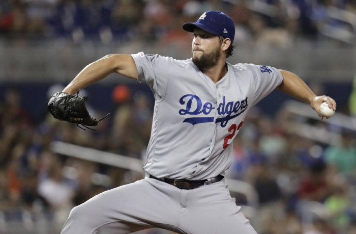 Los Angeles Dodgers starting pitcher Clayton Kershaw throws during the fourth inning of the team's b...